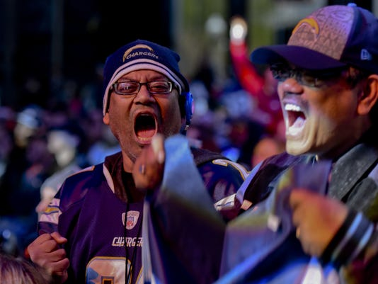 San Diego Charger fans celebrate after Joey Bosa was selected by the San Diego Chargers as the number 3 pick in the first round of the 2016 NFL football draft at Selection Square in Grant Park, Thursday, April 28, 2016, in Chicago. (AP Photo/Matt Marton)