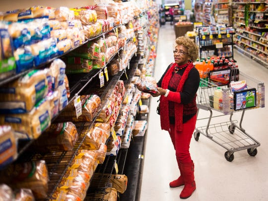 """Ruth Wideman of Anderson buys bread Thursday in preparation for the forecast snowstorm at the Ingles market on North Main in Anderson. """"I'm grabbing bread and milk and everything else to prepare,"""" Wideman said."""