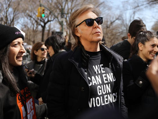 Sir Paul McCartney joins thousands of people, many