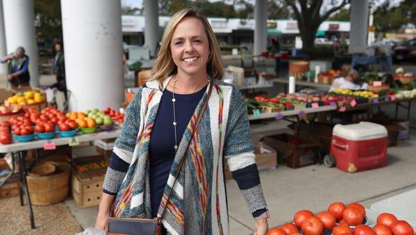 Dietitian Anna Jonesstands at the Market Square Farmer's