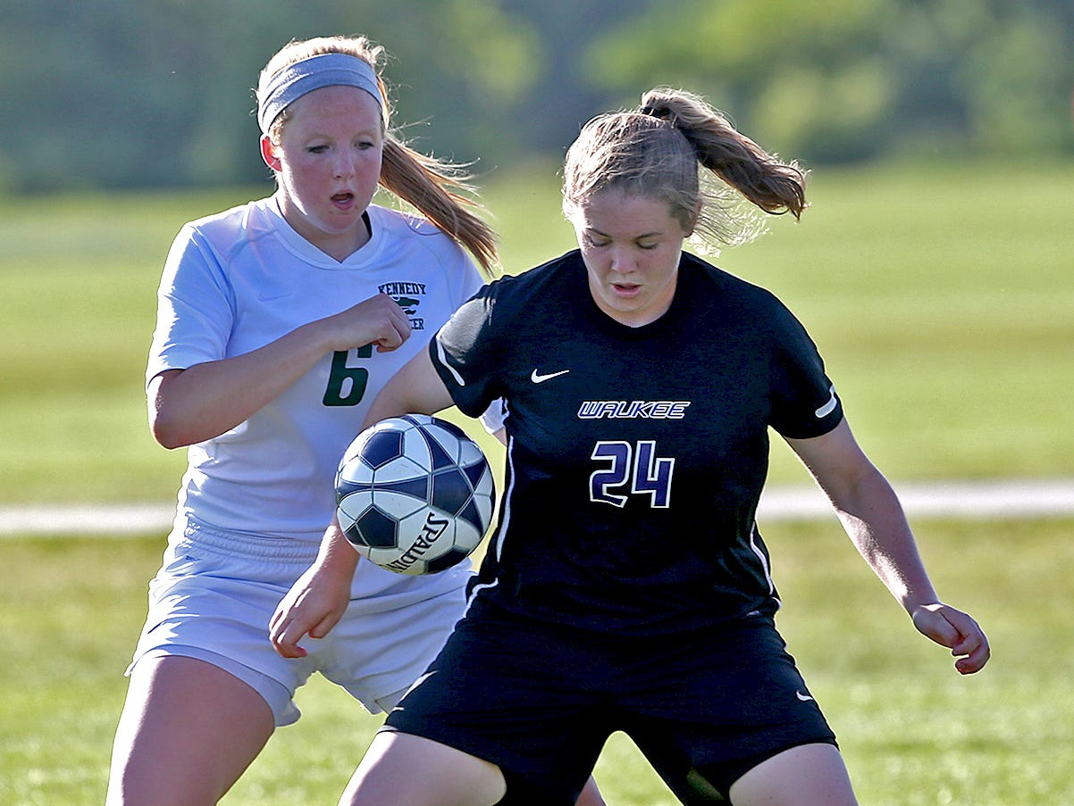 Waukee's Ellie Cavanaugh, right, is part of a Warriors program that has hit a roadblock in the Class 3-A semifinals the past three seasons. Cavanaugh, her teammates and coach Tony Gabriel hope 2015 is the year to break the title seal.