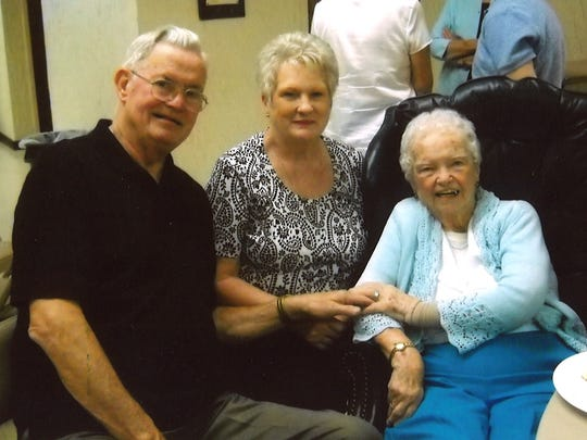 Jim and Beverly Griffin pose alongside Sister Rose Margaret Noonan at Owens Hall in St. James Church in Johnson City.