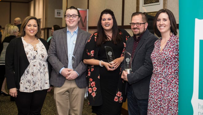 Outstanding Young Professionals award winners Caleb Smith, Brittany Irvine and Matt Smith pose for a photo with Alyssa Tegeler and Melissa Vance during a luncheon, presented by HYPE Richmond and the Wayne County Area Chamber of Commerce, at Lingle Hall inside Reid Health on Thursday, April 12, 2018.