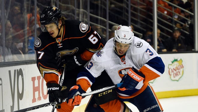 New York Islanders defenseman Travis Hamonic (right) is under contract for four more seasons after this one.