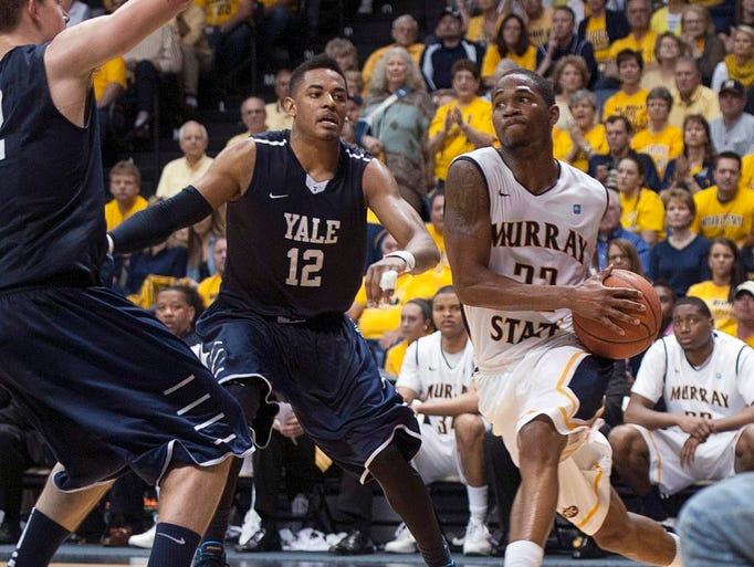 Murray State's T.J. Sapp drives to the basket against Yale's Armani Cotton during the second half in an NCAA college basketball game for the CollegeInsider.com tournament championship, Thursday, April 4, 2014, in Murray, Ky. (AP Photo/The Ledger, Kyser Lough)