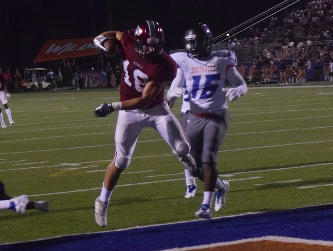 Pineville High School's Ben West (far left) leaps into