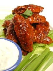 Baked Buffalo-style chicken wings.