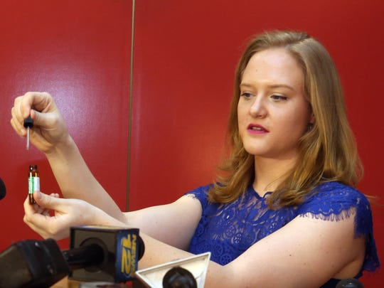 Hillary Peckham, Chief Operating Officer of Etain, displays a bottle that would hold medical marijuana in tincture form during a ceremony to mark the opening of Etain LLC medical marijuana dispensary on Main Street in Yonkers March 30, 2016. The medical marijuana that will be dispensed by the company will come in various oil based forms.
