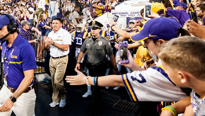 LSU Tigers head coach Ed Orgeron taking the field with the Tigers on Saturday October 15, 2016 BUDDY DELAHOUSSAYE/ THE ADVERTISER