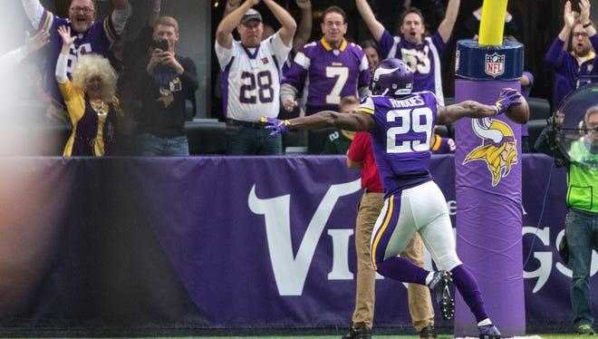 Minnesota Vikings cornerback Xavier Rhodes (29) returns an interception 100 yards for a touchdown during the second quarter against the Arizona Cardinals.