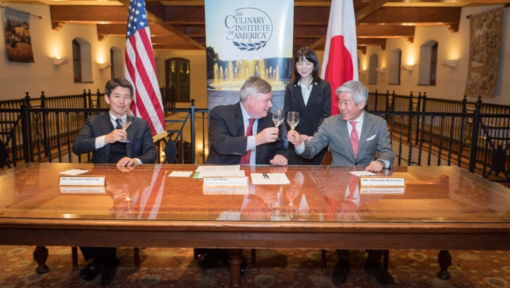 From left to right, Asahi Shuzo President Kazuhiro