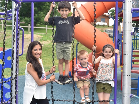 From left, Gigi Matacia, of Highland, with her children Dylan, 7, Jake, 2, and Madison, 8, at Bowdoin Park in Wappingers Falls on Wednesday. Matacia is currently in the process or applying for for state child care subsidies.