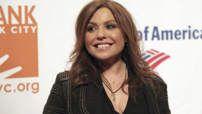 FILE - In this April 9, 2014 file photo, Rachael Ray attends the Food Bank of NYC Can Do Awards Benefit Gala on in New York.  Officials said Friday, Aug. 21, 2020 that a fire that tore through celebrity chef Rachael