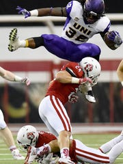 UNI's Tyvis Smith jumps over USD's Jacob Warner during