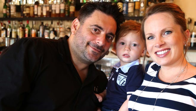 Gio Osso and his son, Nico, and wife, Bethany. Osso plans to open a new restaurant in downtown Gilbert in the winter.