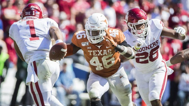 Players like Texas' Joseph Ossai, seen here pressuring Oklahoma's Jalen Hurts last year, aren't being allowed to hit as much in practice as the coaching staff deals with where the players are physically due to the loss of earlier workouts amid pandemic concerns.