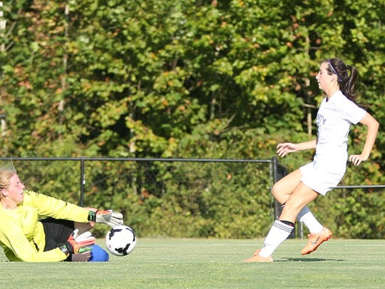 Madison goalkeeper Hailey Smith makes a save on a shot from TCA's Brynne Lytle on Tuesday.
