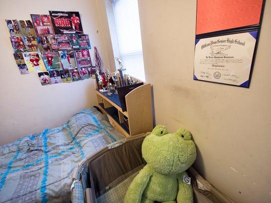 Da'Keem Dennison's bedroom with his high school deploma and bassinet for his daughter Wednesday.