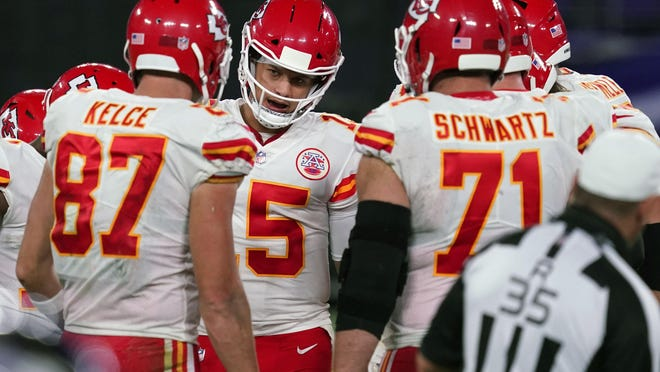 Kansas City Chiefs quarterback Patrick Mahomes (15) leads the huddle against the Baltimore Ravens at M&T Bank Stadium last Monday.