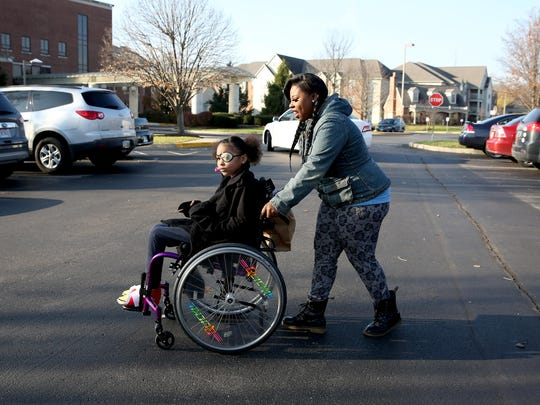 Toshia Kinebrew pushes her daughter China Kinebrew, 6, to her occupational therapy appointment Tuesday Dec. 8, 2015. China was shot July 6 in Avondale leaving her paralyzed and without her left eye.