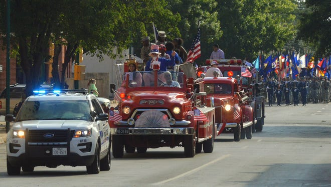 A Wichita Falls Police Department vehicle begins the 33rd annual Old-fashioned Fourth of July and Most Patriotic Parade Tuesday in downtown Wichita Falls in celebration of the nation's birthdya and Independence Day.
