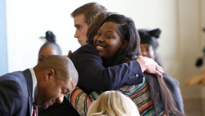 Sam DuBose's daughter, Raegan Brooks, receives a hug after being named administrator of her father's estate during a court hearing Thursday afternoon.