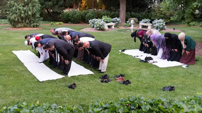Prayers are performed just before sunset at a Ramadan dinner former Gov. Jack Markell hosted for Muslim leaders at Woodburn, the governor's mansion, in Dover in 2016.