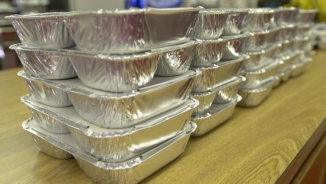 A stack of portable lunches wait for Meals on Wheels volunteers to pick up and deliver to Cedar Park residents.