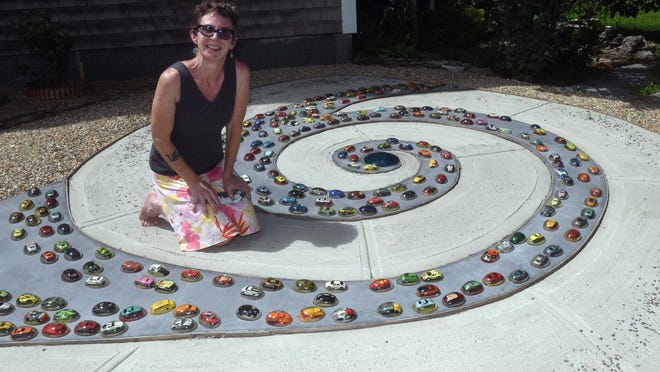 "Artist Kris Lanzer began working on ""Dover Traffic Spiral"" two years ago and finished the piece just recently at 93 Stark Ave., where she lives."