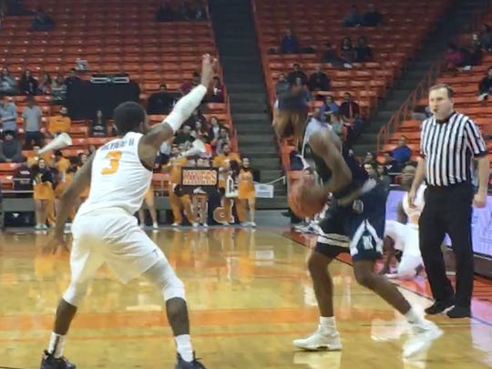 UTEP's Evan Gilyard defends Rice's Ako Adams during UTEP's game with Rice on Saturday night at the Don Haskins Center.