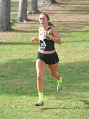 Courtney Britt races down the hill in the final stretch