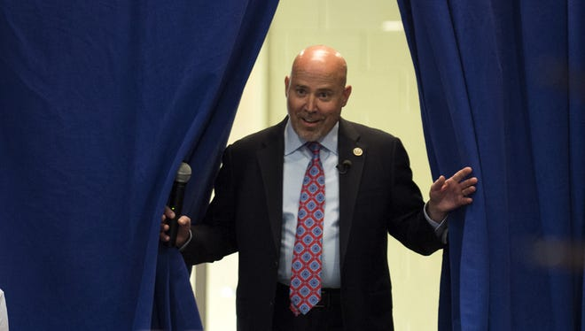Congressman Tom MacArthur (R-NJ) makes his entrance for a town hall meeting in Willingboro.