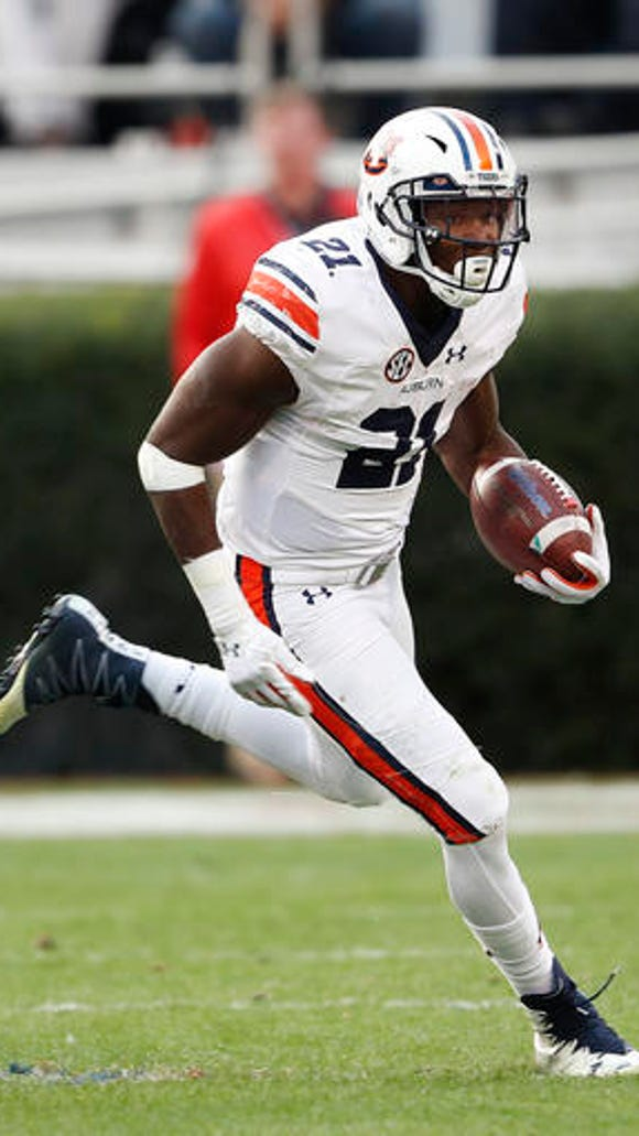 Auburn running back Kerryon Johnson (21) runs against Georgia in he first half of an NCAA college football game Saturday, Nov. 12, 2016, in Athens, Ga.