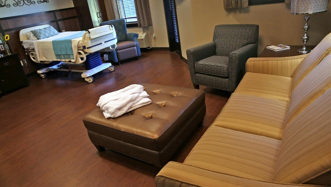 A pull-out couch is seen in one of the patient rooms at the new Franciscan St. Francis Hospice House on Sept. 16, 2015. Two TVs for different parts of the room can accommodate patient and family.