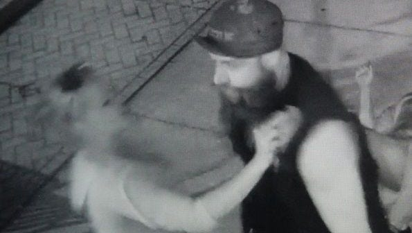Titusville police are searching for the identity of a bearded man who kicked a woman in the head