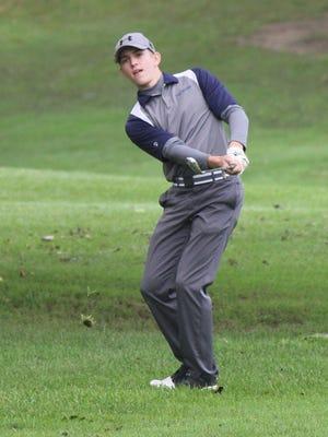 Darin Hudak hits an iron shot during the 2018 Suburban League Postseason Tournament. Hudak, now a senior, has been the Tallmadge boys golf team's top player for the last three years.