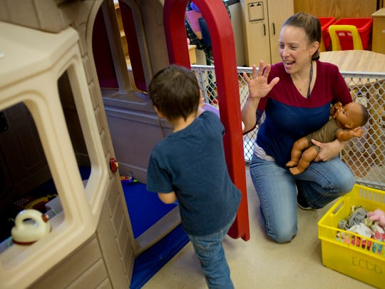Paraprofessional Jessica Albert works with a student in a Early Childhood Special Education classroom Thursday, November 5, 2015 at Kimball Elementary School.