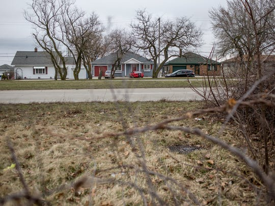 Home are seen across from a wooded vacant lot Tuesday, March 15, 2016 along Gratiot Avenue in Marysville. The city has created a new industrial development district bordered by Gratiot Avenue, Ravenswood Road, and train tracks to the west.