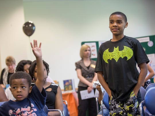 Caleb Duren, 12, of Port Huron, answers a question about the history of slavery in America during the Juneteenth celebration Friday, June 17, 2016 at the Donald Dodge auditorium in the St. Clair County Administrative Building in Port Huron.