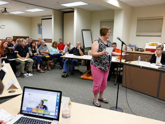 Fairfield resident Carol Meyers voices her opinion against the guidelines dealing with transgender students Monday, Aug. 15, 2016, in Fairfield, Iowa.