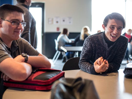 Azim Saidov, 18, right, sits with Seth Lozano, 17, and laughs while talking with friends during the lunch hour Thursday, Nov. 3, 2016 at Landmark Academy in Kimball Township.