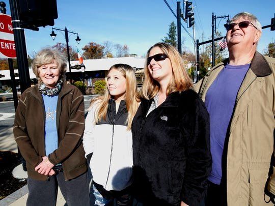 Lis Gessel of New City, along with her daughter, Victoria Richey, 14, and parents Sarah and Rudy Kronbichler, hold a banner  what will be placed on Main Street in New City that will honor Gessel's service in the U.S. Army and her tour in Iraq, on Nov. 10, 2016.