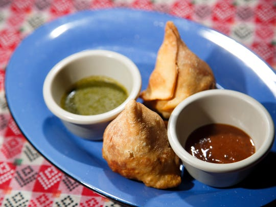 Vegetable samosas with mint and tamarind sauces from