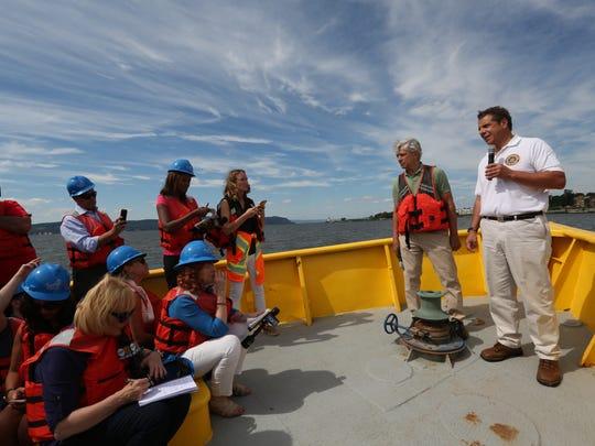Gov. Andrew Cuomo speaks to the media during a boat tour of the new Gov. Mario Cuomo Bridge Aug. 23, 2017.