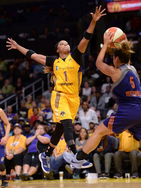 Los Angeles Sparks guard Odyssey Sims (1) defends against Phoenix Mercury's Leilani Mitchell (5) during the second half of a WNBA basketball playoff game Tuesday, Sept. 12, 2017, in Los Angeles. The Sparks won 79-66.(Stephen Carr/Los Angeles Daily News via AP)