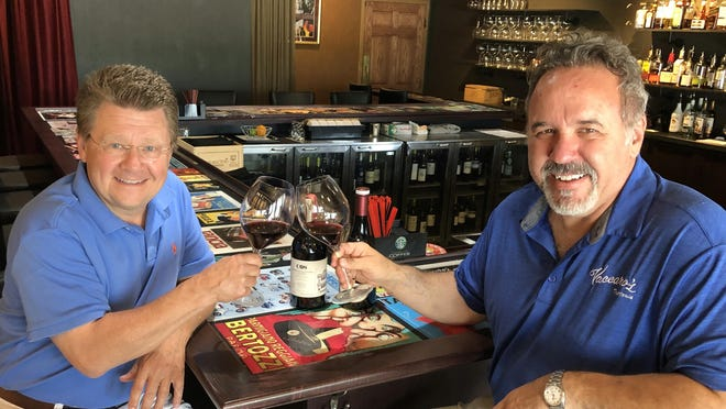 Phil Masturzo has a glass of wine with Raphael Vaccaro in the new 22-seat bar at Vaccaro's Trattoria.