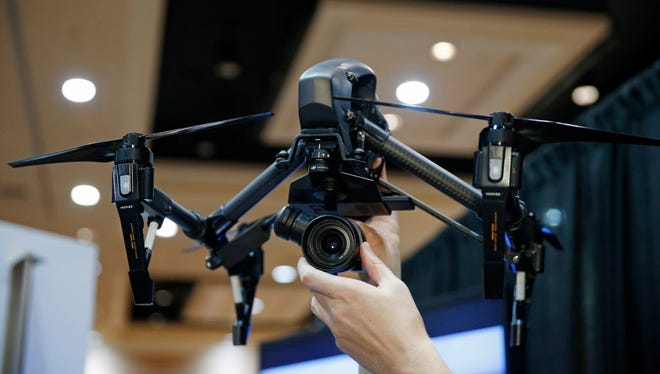 The DJI Inspire Raw drone helicopter is on display at the Consumer Electronics Show in Las Vegas on Jan. 4, 2015.