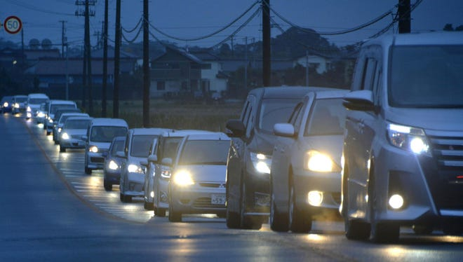 Vehicles make a line as they flee following a tsunami warning in Iwaki, Fukushima prefecture early Tuesday, Nov. 22, 2016. Coastal residents in Japan were ordered to flee to higher ground on Tuesday after a strong earthquake struck off the coast of Fukushima prefecture.