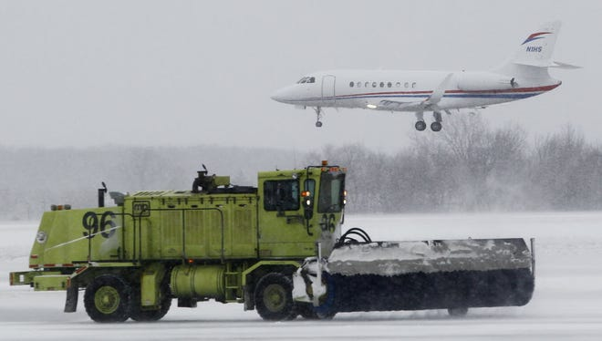 This file photo from December 2015 shows one of the massive brushes used to clear runways at Mitchell International Airport in Milwaukee.