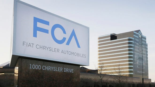 This file photo shows a sign outside Fiat Chrysler Automobiles world headquarters in Auburn Hills, Mich. Fiat Chrysler and Google said Tuesday, April 25, 2017, for the first time will offer rides to the public in the self-driving automobiles they are building under an expanding partnership.